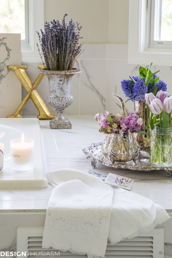 summer refresh bathroom decor with purple flowers