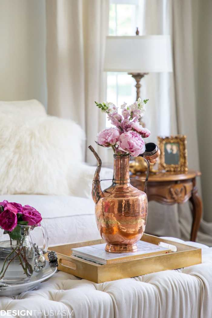 living room decor with pink and copper accents