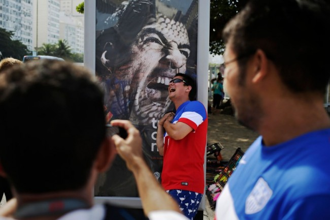 suarezbite2 650x433 World Cup Tourists Take Selfies With Toothy Suarez Ad