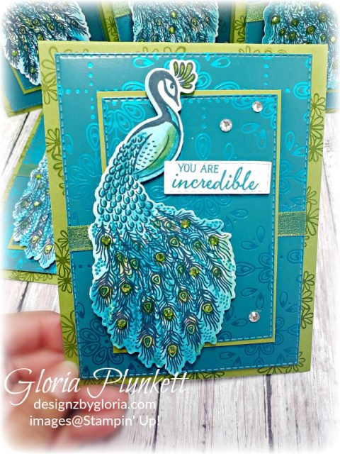 "Royal Peacock stamp set, noble peacock suite bundle, detailed peacock dies, splitcoaststampers, old olive cardstock, 3/8"" reversible ribbon, noble peacock rhinestones, noble peacock specialty designer series paper, beads and baubles embossing folder, whisper white craft ink, black stampin dimensionals, detailed trio punch, basic black cardstock, old olive classic ink,  memento tuxedo black ink, black stazon ink,    thick whisper white cardstock, whisper white cardstock,  stamparatus, aqua painters, blender pens, clear wink of stella, stampin' trimmer, very vanilla cardstock, sponge daubers,  dimensionals, paper snips, multipurpose liquid glue take your pick, SNAIL adhesive, stampin' up! Demonstrator, how to, diy handmade, homemade, rubber stamping, greeting card, crafts cardmaking"
