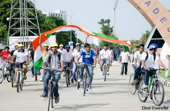 cyclist waving Indian tricolor flag on independence day of India