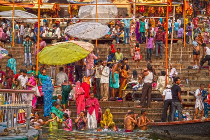 Devotees on Ghats of Varanasi taking a holy bath in Ganges