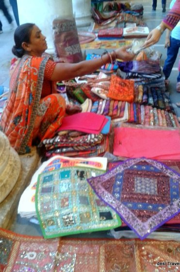 A lady vendor selling handicrafts in Connaught place New Delhi