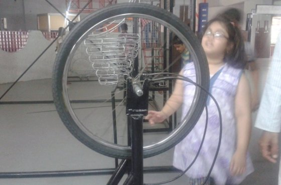 A girl checking a science exhibit at Birla Science Museum and Planetarium (6)