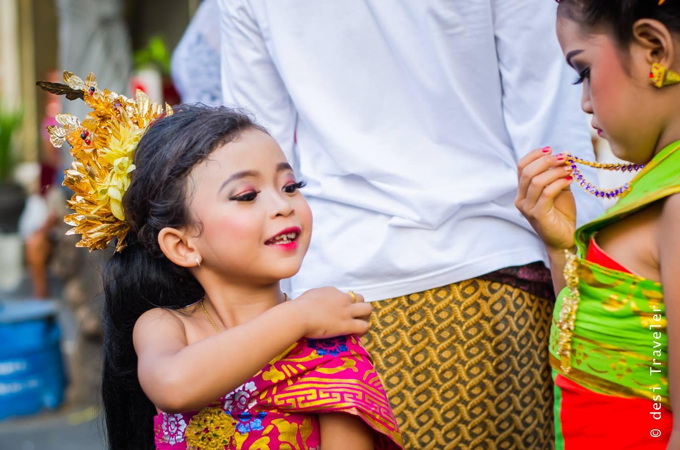 Little girls participating in Hindu Festival in Bali temple