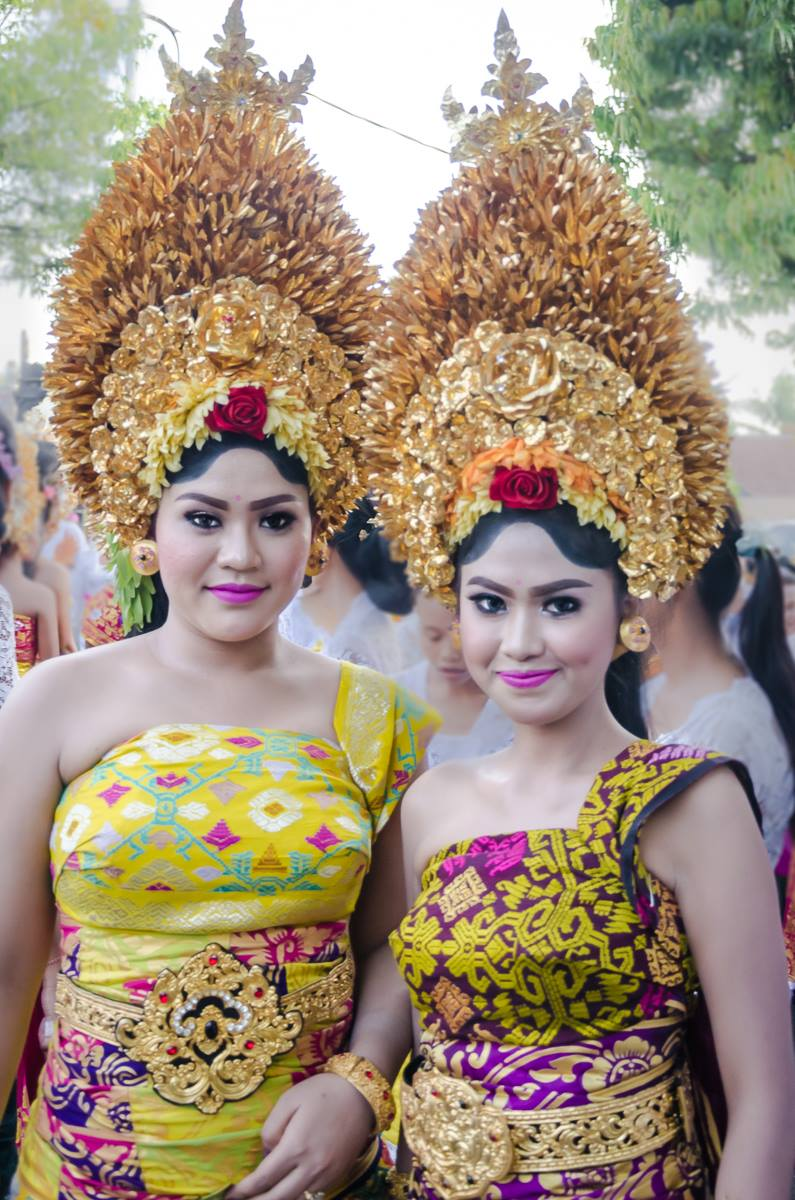 Girls dressed like Hindu Goddess for temple ceremony in Bali Indonesia