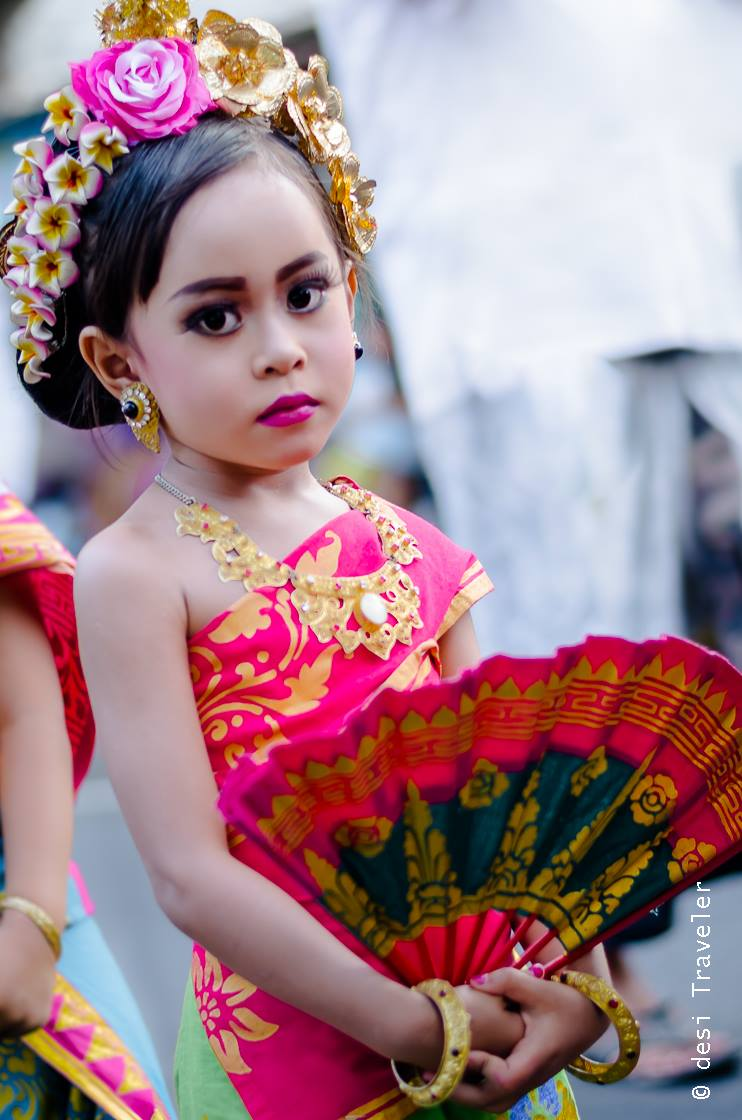 Girl dressed in traditional clothes for Bali Hindu temple festival parade