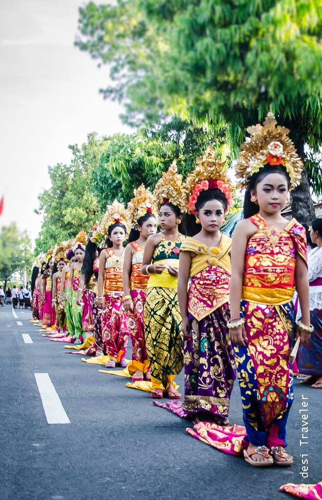 Girls dressed in traditional clothes of Bali for temple ceremony in Sukawati Bali