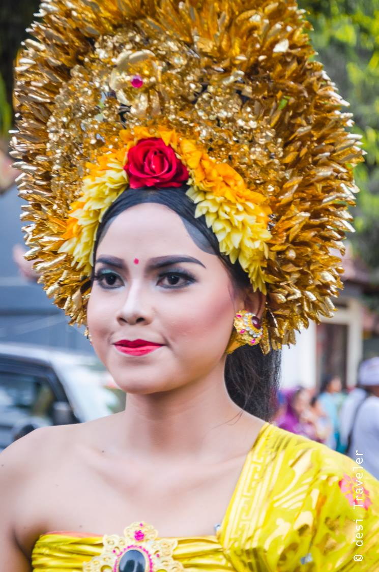 Girl in traditional dress Hindu Temple Festival Parade Bali Indonesia