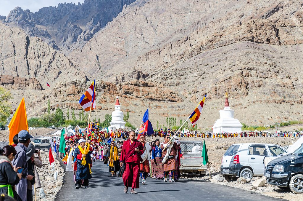 Monks carrying 6 Bone Ornaments for Naropa Festival