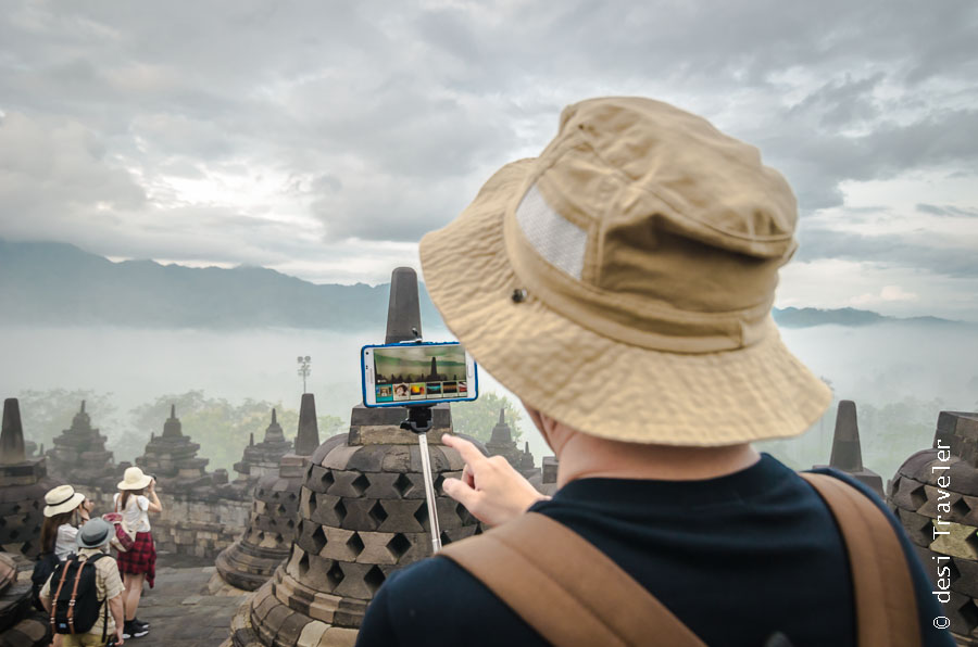 Tourists in hats at Borobudur Temple