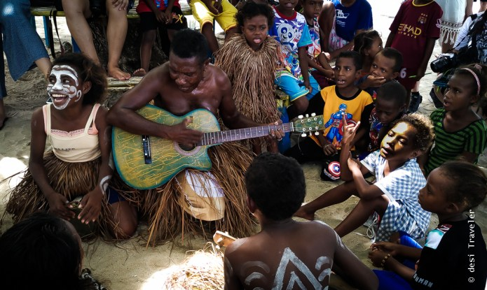 Papua tribal sing welcome songs Arborek tourism village Indonesia