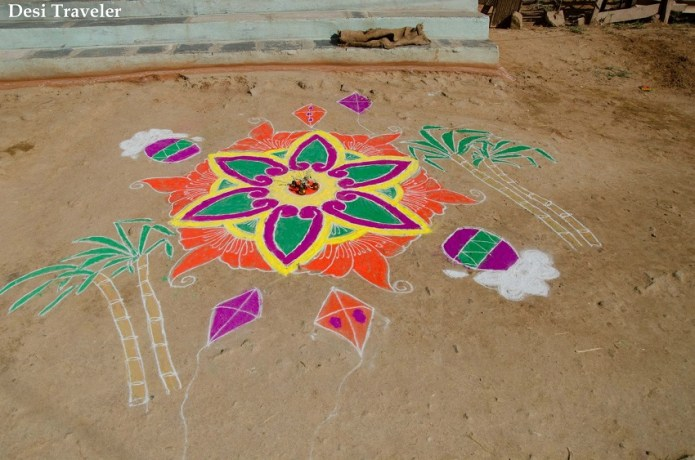 A traditional Rangoli design with sugarcane, kites coconuts flowers