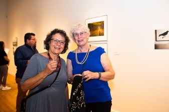 Rosemary Strembicki talking with an exhibit attendee at the Stan Strembicki & Alumni Art Show Opening Reception, Des Lee Gallery, St. Louis, MO