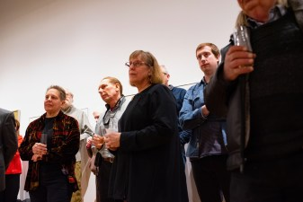 Family members listen to remarks at the Robert C. Smith Retrospective Exhibit Opening, Des Lee Gallery, St. Louis, MO
