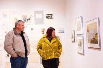 Eva and Eric Bischoff view work at Robert C. Smith Retrospective Exhibit Opening, Des Lee Gallery, St. Louis, MO