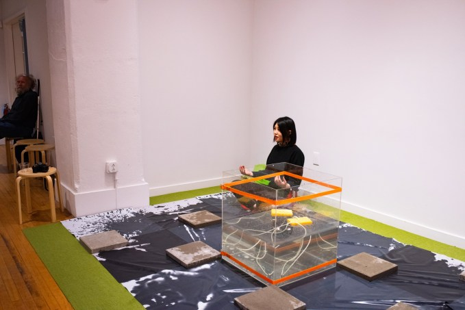 """Artist Jiyoung Lee sits within her installation """"30minutes"""" at the BFA 2 Show on display at the Des Lee Gallery, Washington University, St. Louis, MO"""