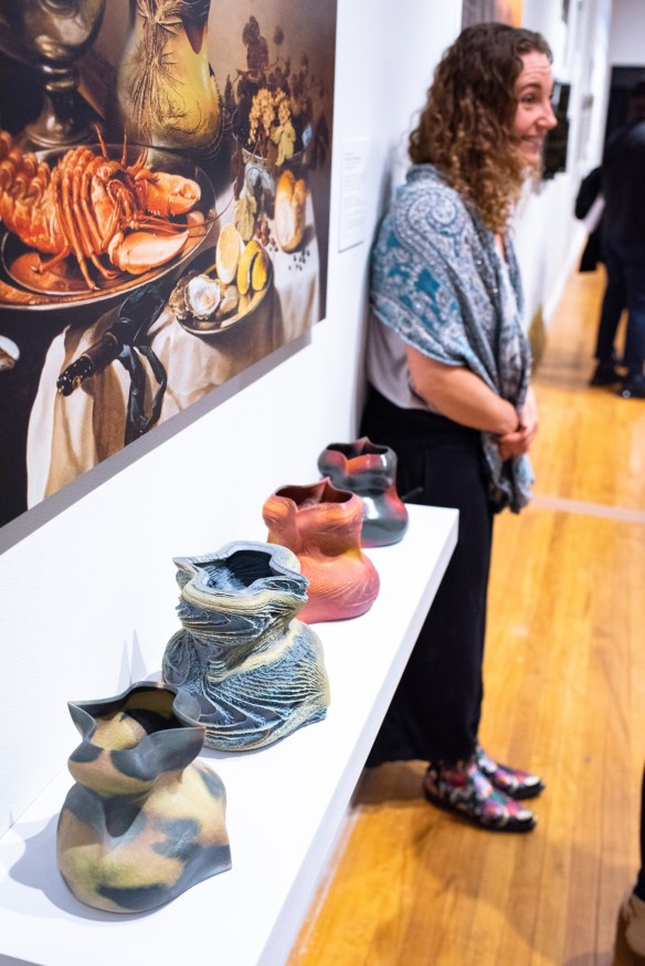 """Sarah Knight by the """"Still Life Interventions, 2014 with Emmanuel Osono by Kutan Ayata & Michael Young of Young & Ayata"""" at the """"Decoys and Depictions: Images of the Digital"""" Exhibition at the Des Lee Gallery, Washington University, St. Louis, MO"""