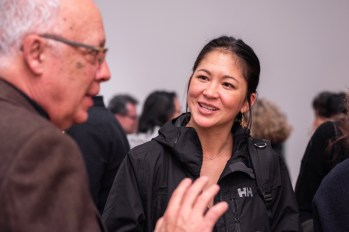 """Prof. Emeritus Buzz Spector (l) talks with Prof. Valerie Greer at the Opening Reception of the """"Decoys and Depictions: Images of the Digital"""" Exhibition at the Des Lee Gallery, Washington University, St. Louis, MO"""