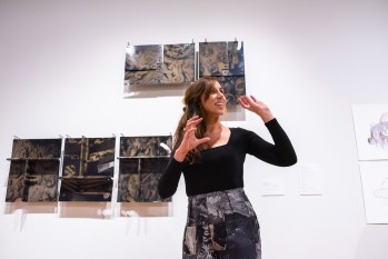 """Assistant Prof. Constance Vale gives remarks at the opening Reception of the exhibit she curated titled """"Decoys and Depictions: Images of the Digital"""" Exhibition at the Des Lee Gallery, Washington University, St. Louis, MO"""