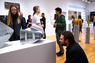 """Andrea Trinkle (l) and Mason Radford (r) view work at the """"Decoys and Depictions: Images of the Digital"""" Exhibition at the Des Lee Gallery, Washington University, St. Louis, MO"""