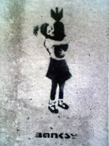 banksy-graffiti-street-art-girl-with-a-bomb