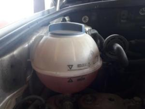 overheating-car-coolant-bottle