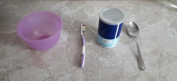 baking-soda-toothbrush-plastic-bowl-tablespoon