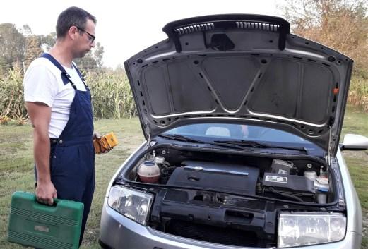 car-repair-standing-by-the-car