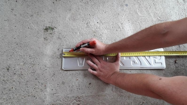 measure-license-plate-for-drilling-holes