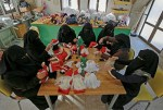 Veiled Women Make Santa Dolls in Gaza Strip