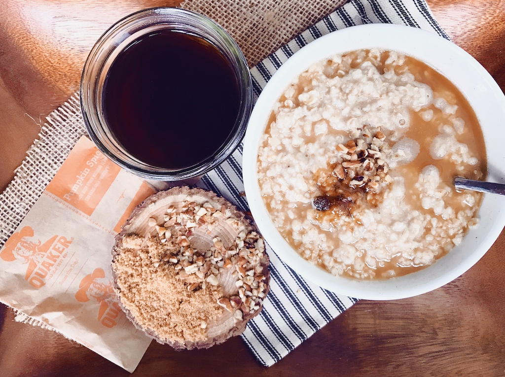 For a quick and cozy breakfast, make a pumpkin oatmeal latte with pumpkin spice coffee and a sweet topping made with brown sugar and pecans.