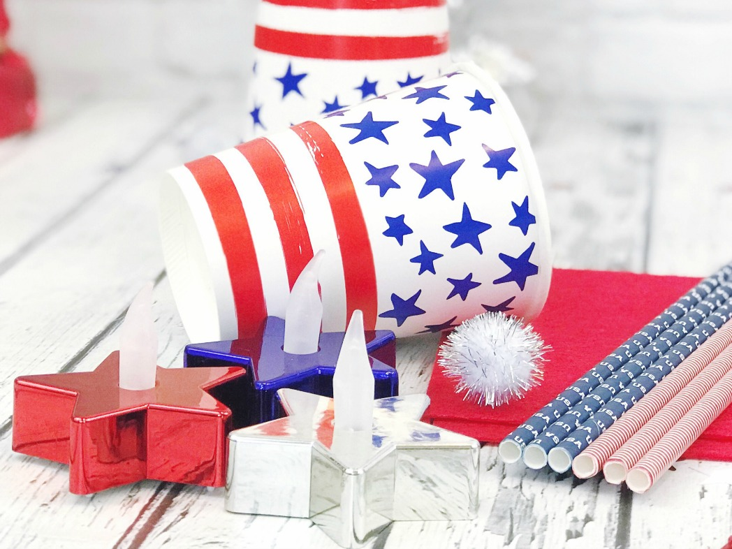 Supplies for patriotic flameless torches including star shaped tea lights and paper cups.