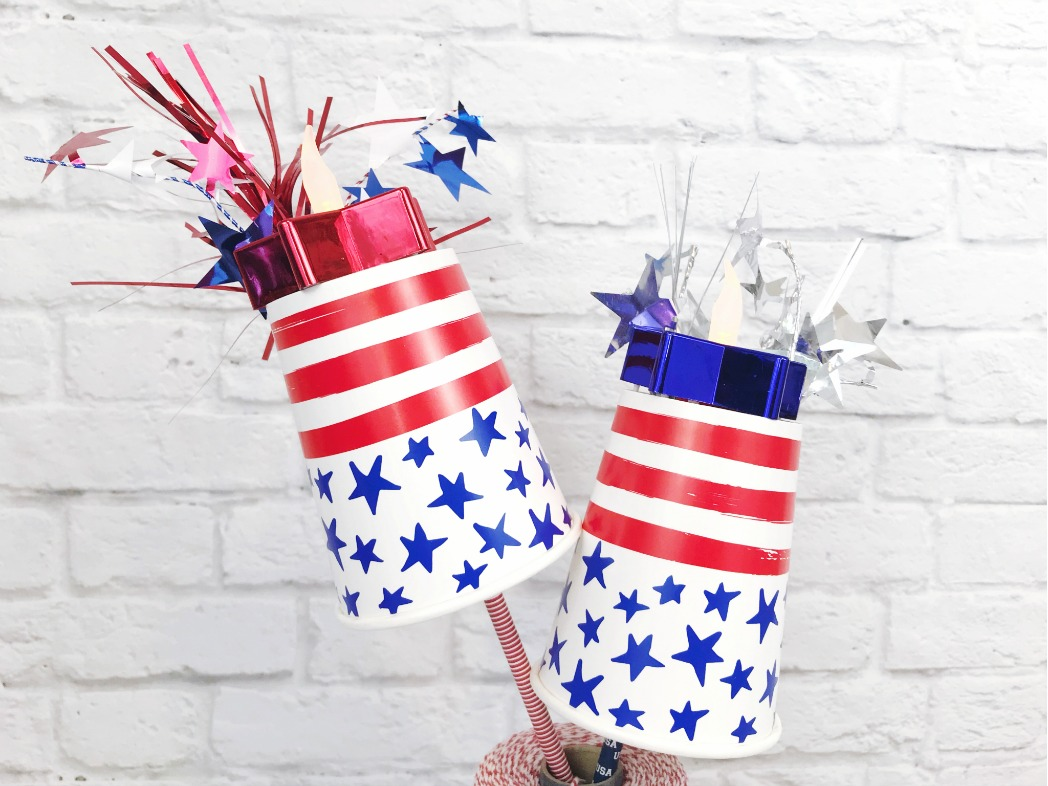 Patriotic Flameless torches made out of paper cups and star shaped tea light candles.