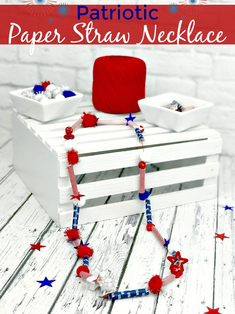 Patriotic Paper Straw Necklace made from pom poms, paper straws, and jingle bells.