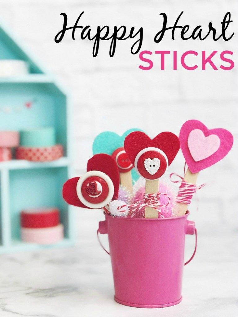 Happy Heart Sticks make a quick and easy kid's craft for Valentine's Day with basic craft supplies you probably have on hand. #craft #popsicesticks #valentinesday