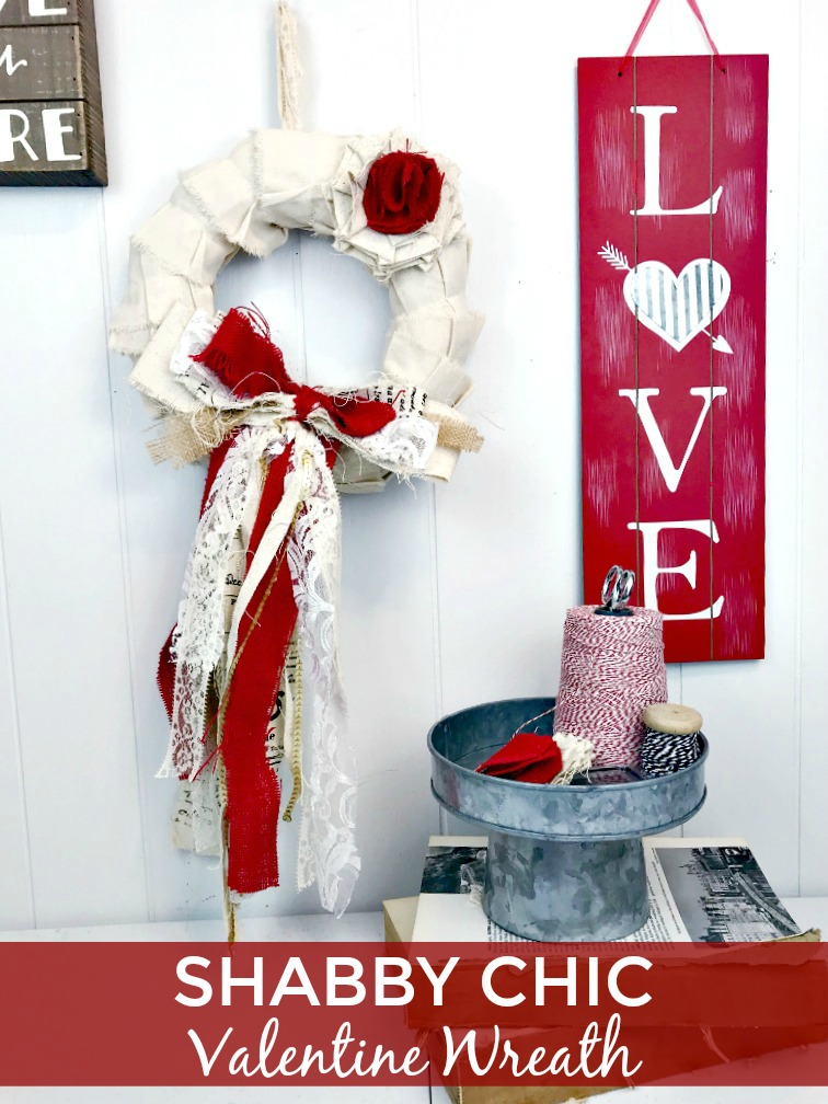 Shabby chic Valentine Wreath hanging with Valentine signs