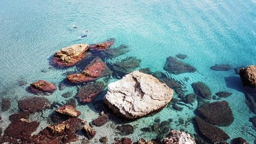 Swimming in the blue water of Nerja