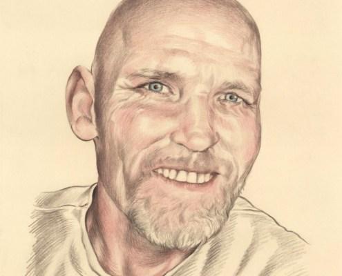 Portrait dessin d'un homme aux yeux bleus souriant