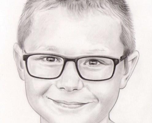 Portrait dessin d'un jeune garçon à lunettes