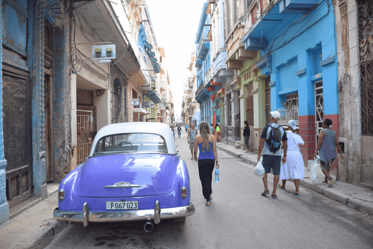 Bailey walks with the locals in Central Havana