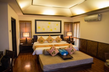 Bedroom in beachfront junior suite at Phi Phi Island Village Beach Resort