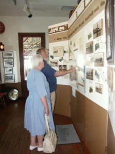 Visitors enjoy an exhibit about the town's early history inside the Chesapeake Beach Railway Museum