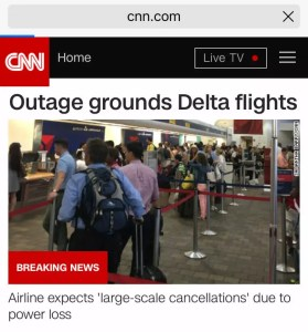 "CNN Headline ""Outage grounds Delta flights"" on 8/8/2016"