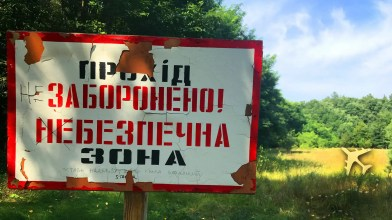 """Duga-1 sign reads """"Prohibited, Dangerous"""""""