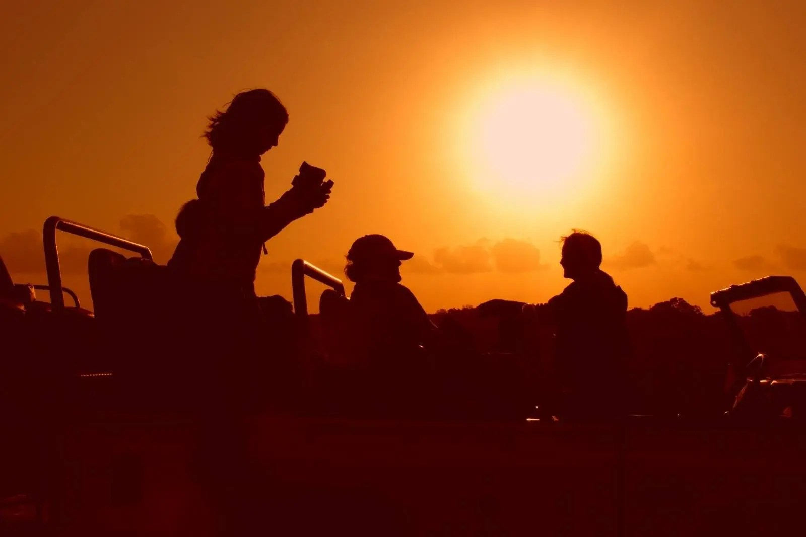 Persons travelling with disability having a light moment watching african safari sunset