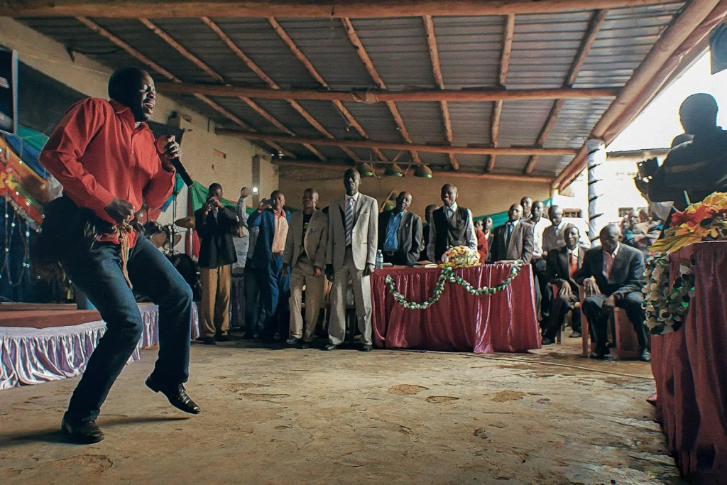 Uganda's Climate, People, and Cultures: A local entertainer at a celebration in Uganda