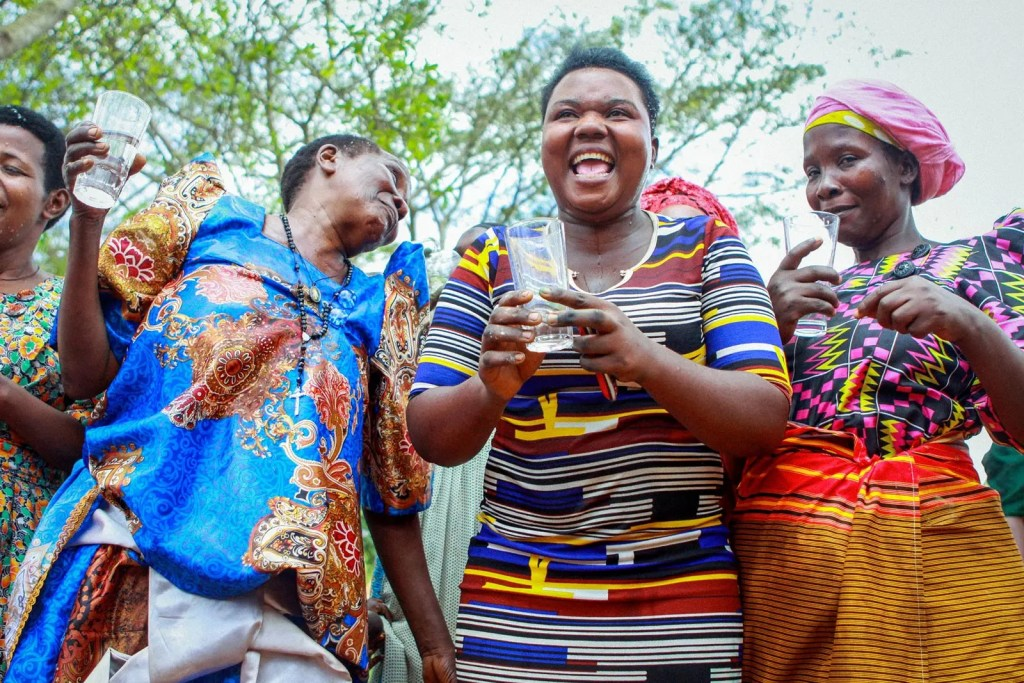 Uganda's Climate, People, and Cultures: Happy elder women in Uganda. Traditional dress is colorful, and happiness is infectious among Ugandans.