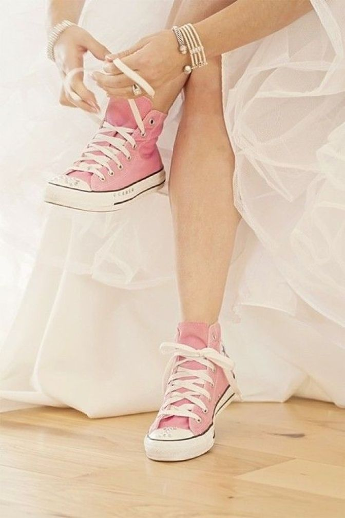 pink high top sneakers with wedding gown