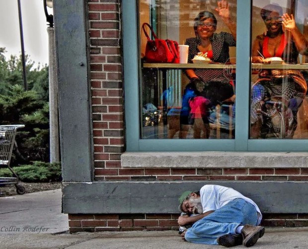 Ignorance-is-bliss-–-Homeless-man-sleeps-outside-a-diner-in-Milwaukee